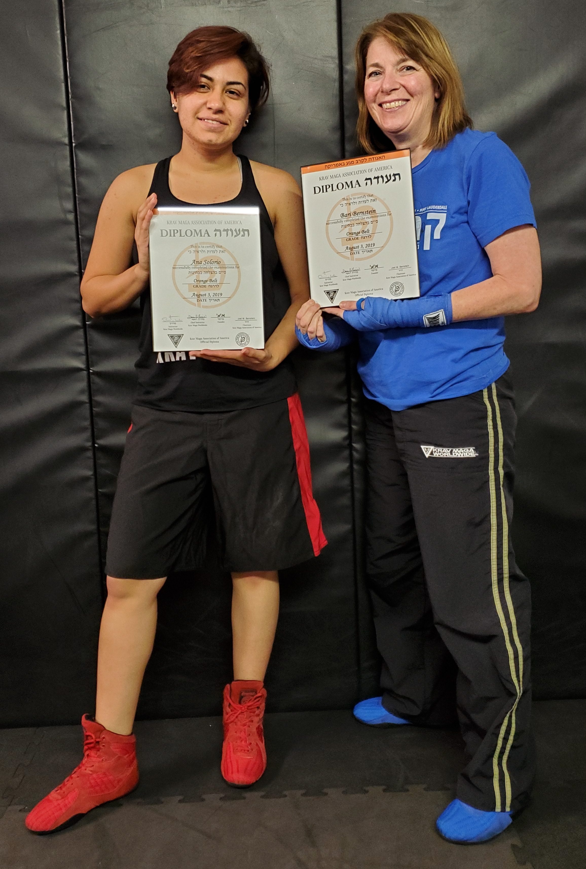 Ana Solorio and Bari Bernstein awarded their Krav Maga orange belt diplomas.