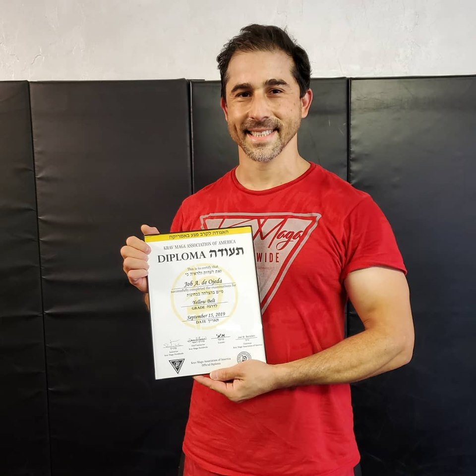 Job de Ojeda receiving his Krav Maga yellow belt diploma