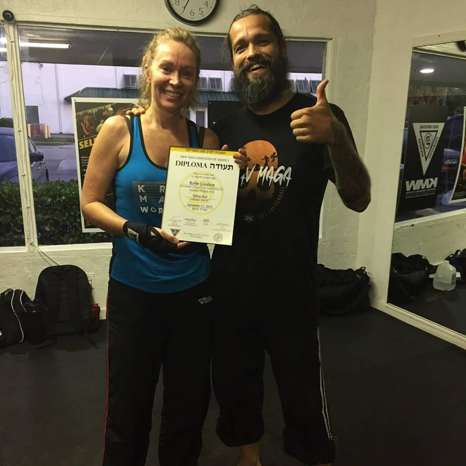 Robin Goodwin receiving her Krav Maga yellow belt diploma