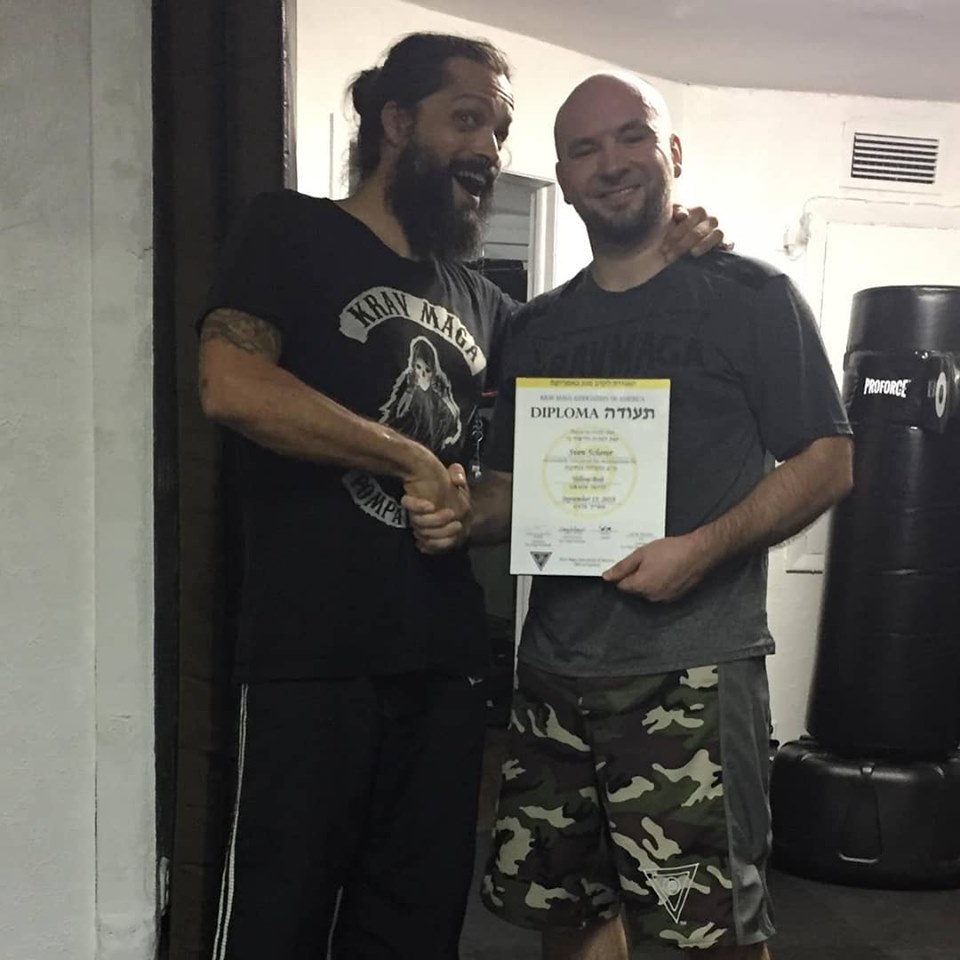 Sven Scherer receiving his Krav Maga yellow belt diploma