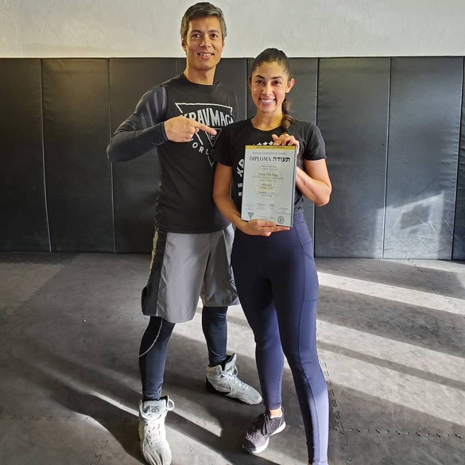 Jessica Chin Fong receiving her Krav Maga yellow belt