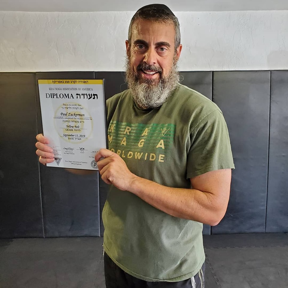 Paul Zuckerman receiving his Krav Maga Yellow Belt diploma